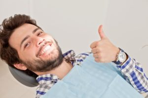 man giving thumbs up after needing an emergency dentist in Burien
